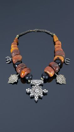 Southern Morocco   Necklace; copal amber, black beads and silver pendants   992€ ~ sold (May '15)