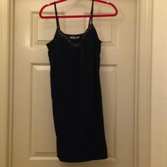 20% off bundles Victoria's Secret Black Dress Size large Victoria's Secret black dress with a shelf bra and beads around neck. This does have loops on the side for a belt or wrap around the waist, but there is no belt included. Victoria's Secret Dresses