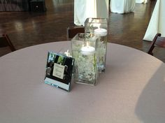 Rustic Contemporary // Wedding table with floating candles and white flower detail