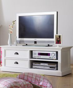 This stylish console has room for all electronics while keeping their wires neatly tucked away. A sleek and elegant addition to any room, it features two drawers for storing movies, games, controllers, remotes and other media accessories plus a sturdy top shelf that's perfect for a television.