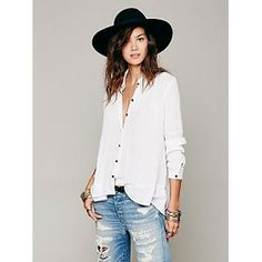 This breezy ruffled button-down screams rock 'n roll muse! // Free People Ruffled Hem Buttondown