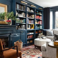 In love with this lacquered library by @meredithheron. Shop the style by clicking on the link in our bio.