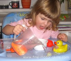 When my daughter is playing the spices game our kitchen smells like some alchemical workshop. It is an extension of the flour game. Except the flour there are different kinds of spices to play with. At the second phase of the game we add some liquids. Usually we use  water only once we used oil. Sometimes we use also food colors. Only my daughter, the containers and utensils, the baby high chair and the floor bellow it need to be cleaned.