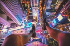 Best images of 2015 | Jacob Riglin peers down at Times Square. Photo: Jacob Riglin / Caters News