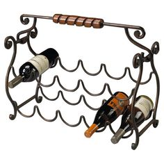 Showcasing a scrolling frame and 1 bottle slots, this charming wine rack is perfect anchored atop a stately sideboard or placed near your home bar.