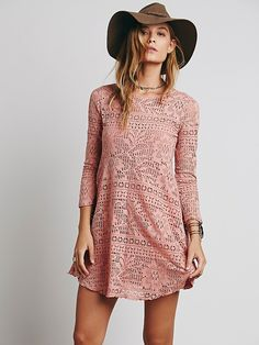 Free People Spring Date Dress, Flirty fit and flare mini dress, with a rounded neck and three-quarter length sleeves, in a sheer crochet lace. Includes a detachable slip. Open in back with button closures.  FP Beach is a collection that embodies the free spirit of the seaside lifestyle with casual knit dressing, lightweight layers, and effortless shapes.   *60% Cotton  *40% Polyester  *Lining: 100% Rayon  Measurements for Small: Bust: 34 1/2 in = 87 3/4