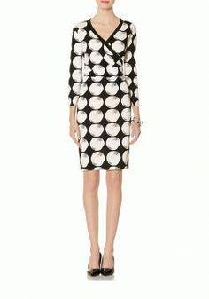 20e27b031b2 It s the kind of dress that you can throw on and go  a classic black and  white print in a low-maintenance wrap style—meaning less time spent putting  an ...