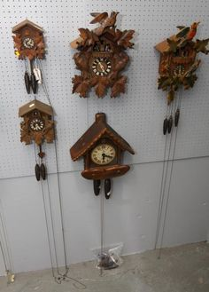 "Five cuckoo clocks incl one marked ""New England Clock The American Cuckoo Bird"", one marked ""W. Germany"", one marked ""Germany"", others unmarked. Largest is 15""x17""T. Clock Collection Auction Ending 3/17/13."