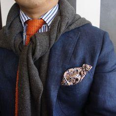 GW with orange knit.