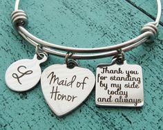 Maid of honor or Matron of honor - handmade personalized wedding bracelet by kriya design  Thank you for standing by my side today and always memorable gift for the special person on your big day  ~ Maid of Honor heart: stainless steel, 3/4 inch across * ~ initial: stainless steel, you pick the letter from drop down menu ~ bangle: stainless steel, expandable, made to fit most adult wrists ~ Thank you for standing by my side today and always, stainless steel 15 mm across  * You can choose...