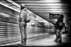 train missed - Subway station in Berlin. A man stands on the platform. A subway runs straight out of the station. Black white street photography from Berlin. #streetphotography #street