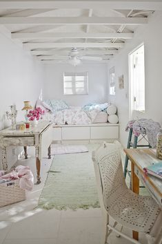 bedroom, cottage, shabby chic, coastal, whites and pastels, sea foam green rug, distressed white wood table, flowers, bright, airy, cozy