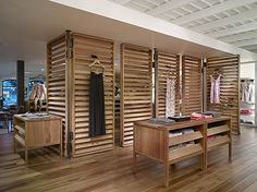 A moveable room divider that serves as a display to hang garments- can adapt to new display.Tommy Bahama Laguna Beach | Standard | Architect