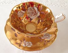 Gold Queen Anne China Tea Cup & Saucer by TheEclecticAvenue on Etsy https://www.etsy.com/listing/236846442/gold-queen-anne-china-tea-cup-saucer