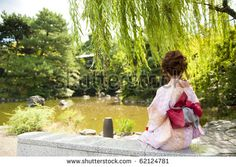 japanese kimono woman looking at the pond