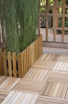 """Deck Tiles - """"They can be used over concrete and directly over grass as long as level"""""""