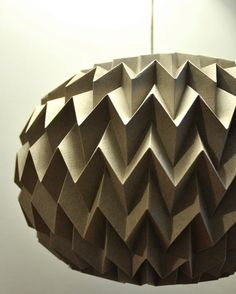 i'm obsessed with these folded paper balls that are handmade by tyART.