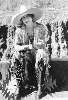 Vera Mcginnis bronc rider first woman in rodeo to wear pants like the men but designed the zipper to be on the side for a more 'feminine' look.