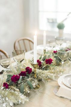 A Metallic Holiday Table -- love this gold, green and red holiday table on a champagne-hued tablecloth!