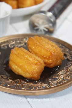 Tulumbe - deep-fried dough sweetened with syrup.