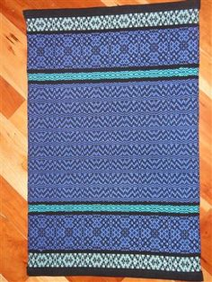 Sampler rug. Like this idea to try out patterns.
