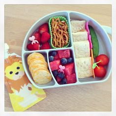 Soy cheese sandwich; baby cucumber & cherry tomatoes; watermelon & blueberries. For snacks there's: soy yogurt; strawberries; pretzels & rice crackers.