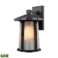 View the Elk Lighting 87092/1-LED 1 Light Lantern LED Outdoor Wall Sconce with Copper Glass Shades from the Brighton Collection at LightingDirect.com.