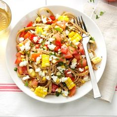 Fresh Corn & Tomato Fettuccine Recipe -Whole wheat pasta tossed with tomatoes, corn, red peppers, green onions and a little feta is a sure-fire winner. —Angela Spengler, Clovis, New Mexico