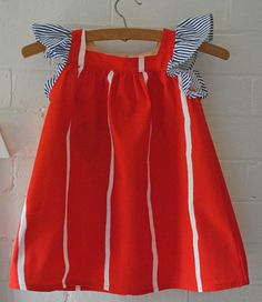 Red dress with navy stripe sleeves from Arty Baby $75 www.artybaby.com.au