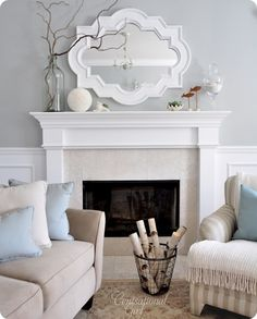 Love the mirror and paint color....Benjamin Moore's Affinity 'Tranquilty' but I had the guys at the BM store tweak it by pulling two drops of blue out of the formula to make it a hint grayer, so we dubbed it 'Tranquility Tweaked'