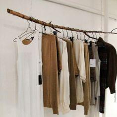 Wood stick clothing rail Image via Stylesight
