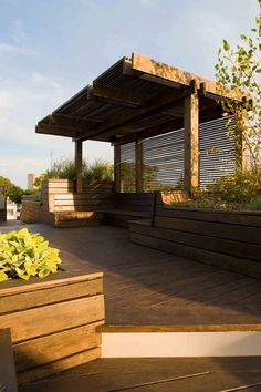 DECK ROOF, would put storage cupboards under the tall plant box to store away cushions in wet weather.