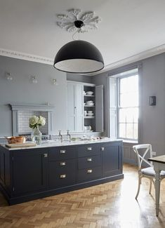 Kitchen Decor The herringbone parquet flooring perfectly compliments the deep blue island in this elegant and modern kitchen. Home Decor Kitchen, Interior Design Kitchen, Modern Interior Design, Contemporary Design, Kitchen Ideas, Kitchen Paint, Kitchen Layouts, Decorating Kitchen, Apartment Kitchen