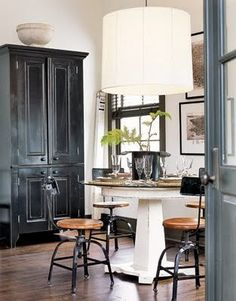 love the scale of the hutch and pendant light over the table.  alice in wonderland in a good way.    country living