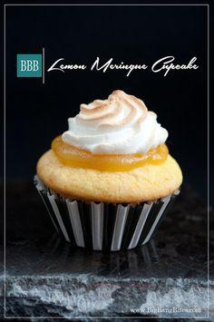 Lemon Meringue Cupcake | Big Bang Bites | bigbangbites.com | Sour cream lemon cupcakes crowned with a tart lemon curd and toasted meringue.