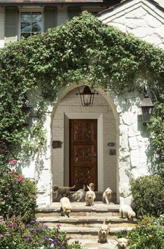 A perfect foliage-covered arched entry with lots of puppys - Collins Interiors