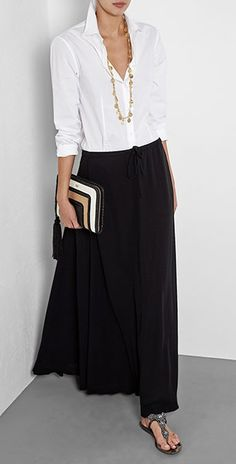 Black maxi skirt paired with a white shirt