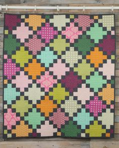 Create a beautiful quilt designed by Amy Gibson! The Irish Chain: Granny Squares Quilt Kit uses fabric that are hand-picked by Amy from Rowan and Free-Spirit fabric collections! Make you're captivating Granny Squares quilt today! Quilting Projects, Quilting Designs, Sewing Projects, Quilting Ideas, Modern Quilting, Patch Quilt, Quilt Blocks, Granny Square Quilt, Granny Squares