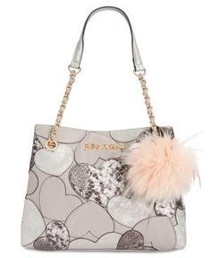 Shoulder up to chic charm-Betsey Johnson's stylish shopper organizes your day-to-night essentials in heart-adorned faux leather finished with a sumptuous removable faux-fur pom-pom. | Faux leather; fa