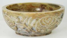 Soapstone Scrying and Smudge Bowl Wonderful as a scrying bowl or for snuffing and resting your smudge sticks, this bowl has been sculpted from soapstone to depict a vivid floral pattern on its exterior. Price: $22.95