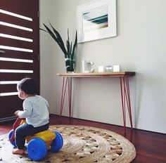 One very happy little boy on our Dandelion rug | See more at www.armadillo-co.com