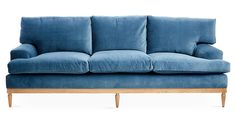 Designed by us and available only at One Kings Lane: Exuding modern elegance, this sofa is set atop a stunningly simple alder frame with an exposed-wood base and tapered legs. Its luxurious blue...