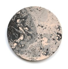 A set of four leather coasters inspired by the textures of the moon's surface. They are made through a process that pays tribute to the Japanese art of ink marbling and happy accidents. Each coaster is individually painted, dyed, and sealed, and is by virtue of this fact, completely unique.Blush/BlackCoaster set comes packaged in a screen-printed, drawstring muslin bag