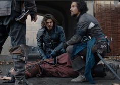 The Musketeers series 3x10. Grimaud sends a message and a dead refugee woman to Athos, Porthos and Aramis. He has Sylvie. BBC