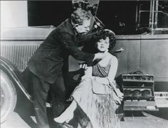 Max Factor touches up Clara Bow's powder between takes
