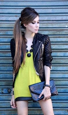 black jacket ,accessories, clutch bag ,pony and a pop of color...Nice