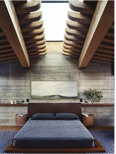A ridiculously cool bedroom in an underground home, obviously topped with a skylight