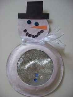 Snowman with snowglobe belly; use the cut out of the snowglobe for the head and fill the belly with glitter/pom-poms