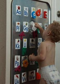 A Magnet Wall. Use rubber cement to paste the alphabet (or whatever you want!) to the giant drip pan. Use the 3M picture hanging velcro to affix the metal pan to the wall.