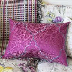 DESIGNERS GUILD BASILICA FUCHSIA THROW PILLOW A wonderful and easy to use fuchsia pink silk cotton reversible throw pillow, jacquard woven with a subtle rippling texture, and embroidered with a contrast diamond. Silk trimmed on both ends. An elegant addition to any setting. Coordinates beautifully with our Leighton throw pillows.